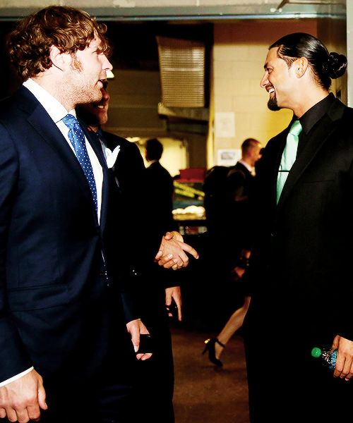 Dean Ambrose and Roman Reigns backstage at the Hall of Fame.