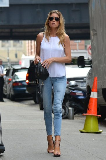 : Doutzen Kroes made her skinny denim way fresh via a stark white tank, tan ankle-strap sandals, and a black MOJO DJ bag.