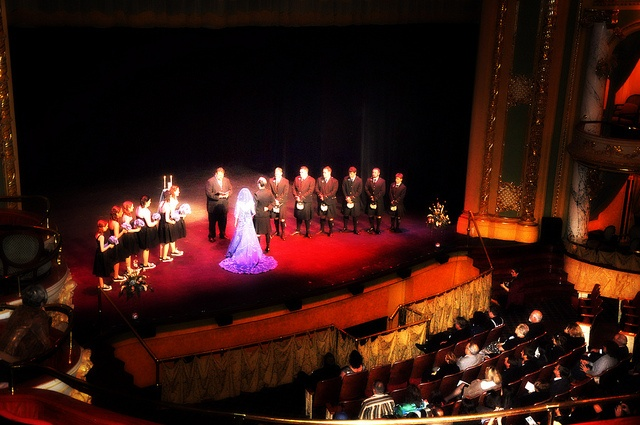 A Moulin Rouge inspired wedding that took place in a theater.