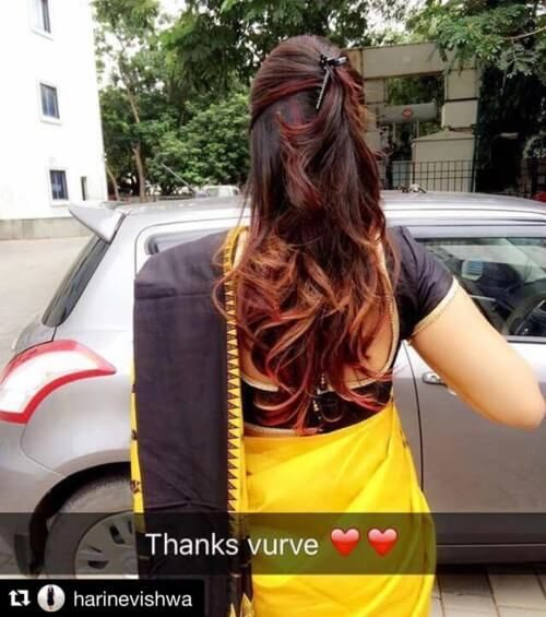 claw clip open hairstyle with saree