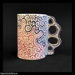 Ceramic cup with hand painted pattern. Ceramiczny kubek z ręcznie malowanym wzorem.