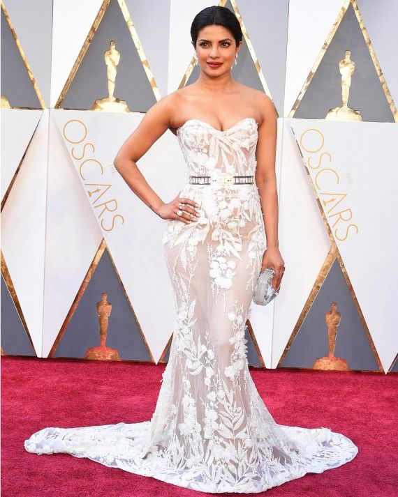 Calling all glam brides! Priyanka Chopra, a presenter at the 2016 Academy Awards, looked gorgeous in a curve-hugging strapless white Zuhair Murad gown complete with a sparkly belt.