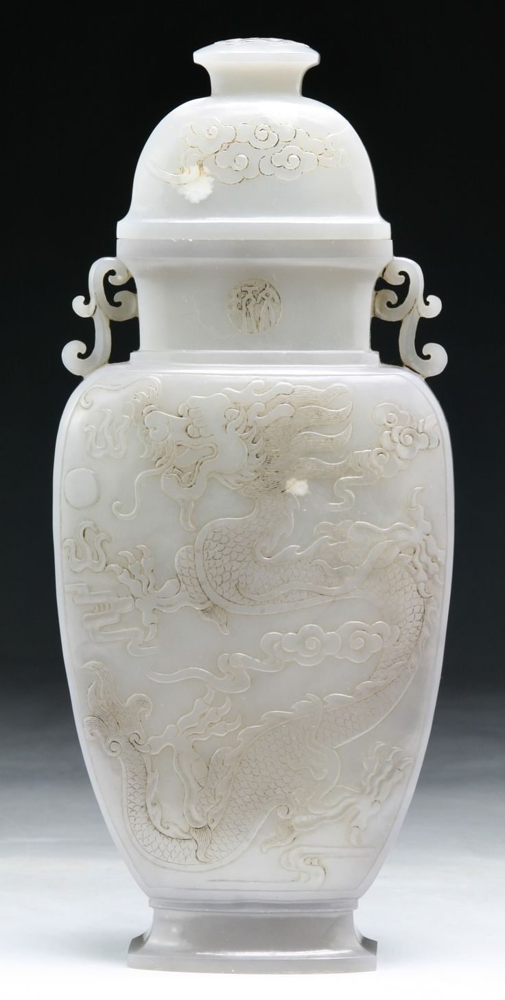 "A Chinese Antique Jade Carved Vase With Cover: of elegant high shouldered form with low relief of circling dragon on both sides, signed 'QIANLONG' on the body Size: H: 10-1/2"" Estimate: $6,000.00 to $12,000.00"
