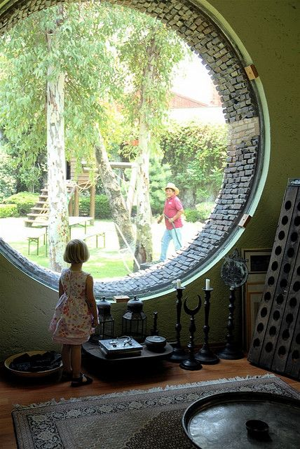 Pauline looking out of round window by moline, via Flickr