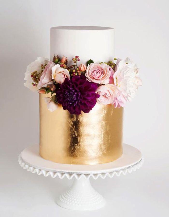 21 Two-Tiered Cakes That Prove Bigger Isn't Always Better - gold and white two tiered wedding cake with floral accents