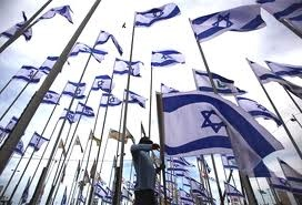 Israeli flags.  What a beautiful sight !!! Makes my heart sing.