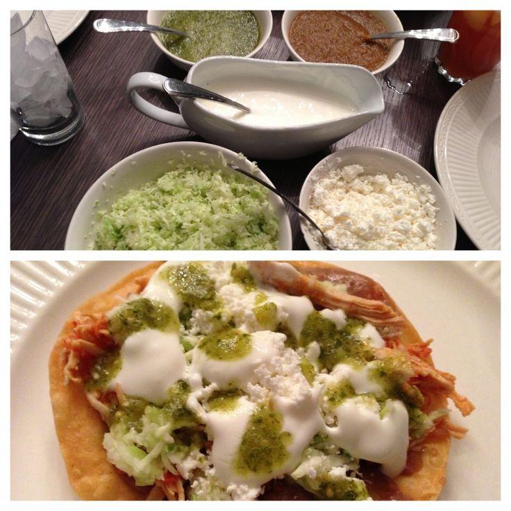 Tostadas de tinga de pollo - Spicy, stewed chicken tostadas. Salsa Verde. Refried Beans.  Crema. Delicious!