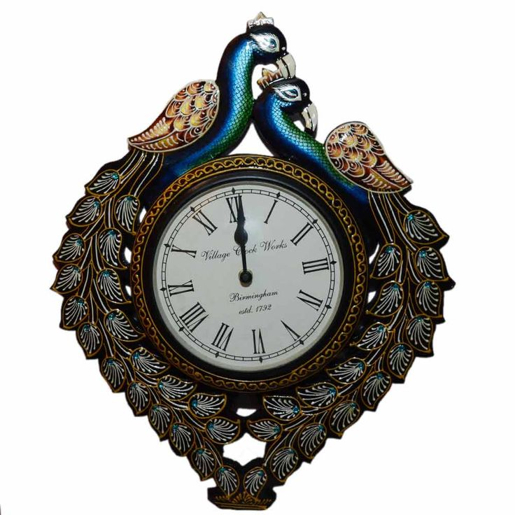 A unique wall clock with elegant peacocks around it is designed artistically. Associated with romantic love and religion in Indian iconography, peacocks are the epitome of beauty and ecstasy. A wall clock is beautifully crafted with proper cuts and immaculate finishing. Bright and iridescent blue, green, gold combination are used for a gleaming look of a peacock.  Click here to buy this product - www.kalakhoj.com