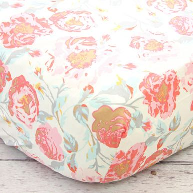 This crib sheet features a fun and vintage floral pattern in pinks, corals, and dusty aquas on a creamy background. Have fun adding this sheet to give your crib a flair of fun in any baby girl's nurse