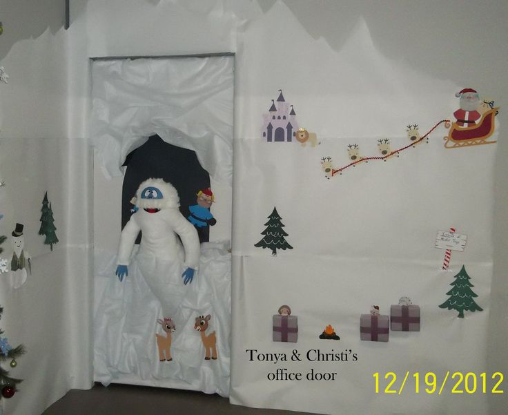 This was our door decoration for 2012.  Had a lot of fun doing it.  Rudolph and the Island of Misfits with the Bumble holding Yukon Cornelius and Hermey in his cave and Santa is on his way to save the day and don't forget Sam the Snowman to tell the whole story.  Tonya & Christi  - Christmas door decoration