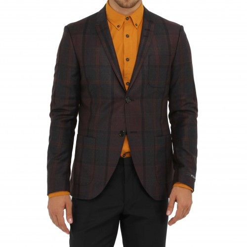 Tiger of Sweden Evert Blazer. A dapper pure wool blazer with an exclusive tartan design. Details include slim peak lapels, patch pockets, two-button closure and double back vents.