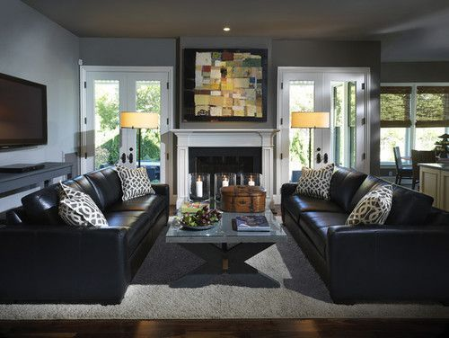 this designer living room is the definition of black leather chic placing two leather sofas