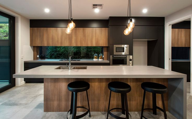 K2 Projects & Big House Little House Moody but sleek modern kitchen with black and timber and glass window splash back