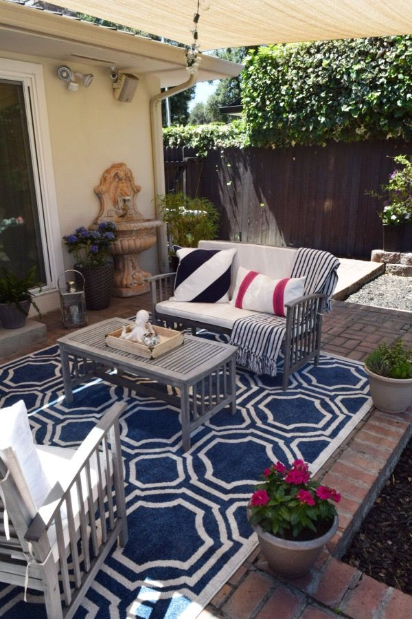 Create an Outdoor Living space! Using toss pillows, throws and coastal accessories will make it feel like an extension of your interior! Available at HomeGoods. Sponsored Pin.
