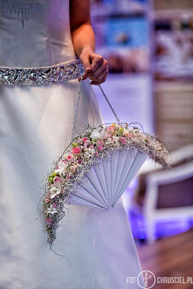 So sweet but modern, fan like purse holding Bridal flowers