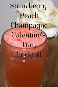 Romantic Valentine's Day cocktail made with champagne, peach schnapps, and strawberry puree