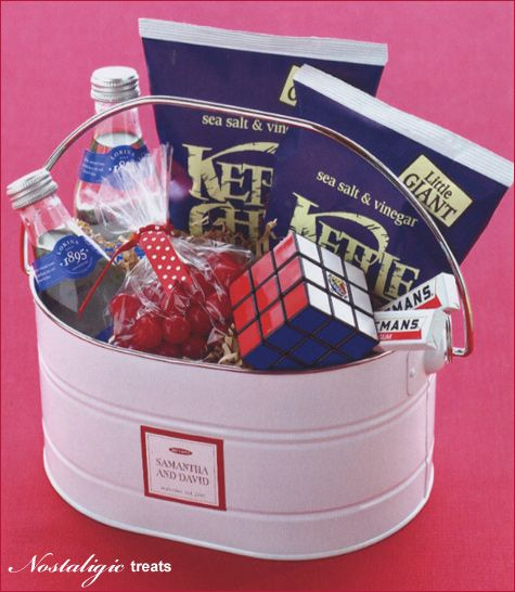 Greet guests with a gift basket of old-fashioned treats like kettle chips, lemonade, and cherry sours