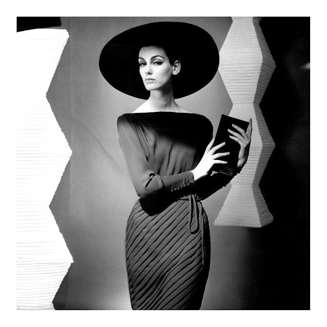 Model Judy Dent in front of Isamu Noguchi's Akari Lamps  Photographed by F.C. Gundlach (1962)
