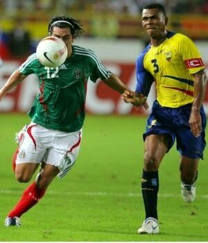 Mexico 2 Ecuador 1 in 2007 in Maturin. Juan Cacho and Ivan Hurtado chase the ball in Group B at Copa America.