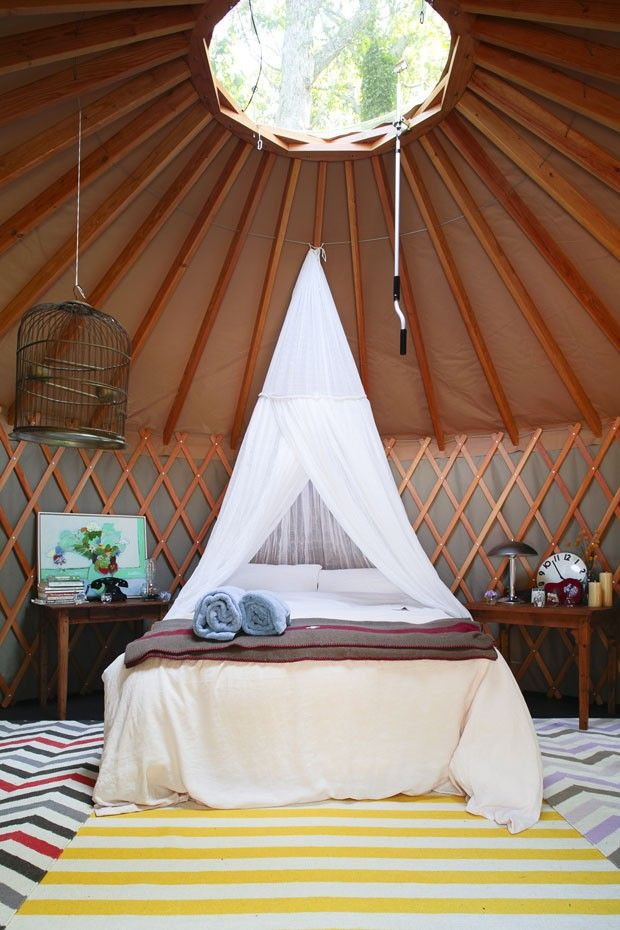 "Nothing says ""Glamping"" like an beautiful yurt with trendy graphic prints! ... and a bird cage..."