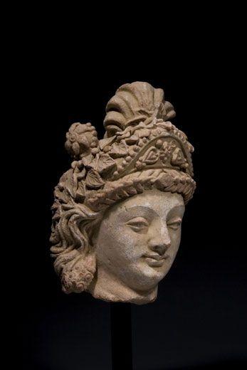 Large terracotta head of a Bodhisattva. Gandhara, Hadda style. 4th-5th Century AD. Height: 13.75 inches (35 cm).