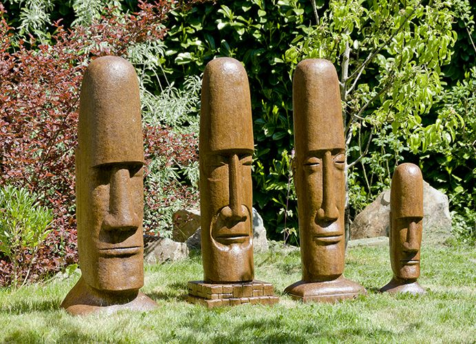 """Tiki Head (left to right) Designed by Klaus Kinast Easter Island 12"""" x 9"""" x36"""" $300 Mesoamerican 11"""" x 11"""" x 36"""" $300 African Tribal 11"""" x 9"""" x 36"""" $300 Easter Island Small 7"""" x 6"""" x 20"""" $100"""