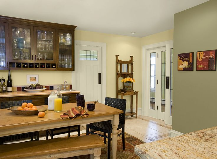 Benjamin Moore Paint Colors - Yellow Kitchen Ideas - Calm, Contemporary Yellow Kitchen - Paint Color Schemes . . . . . In the kitchen, pale yellow and Lapland Green have a calming effect. . . . . . Walls (by doors) - Moonlight (2020-60); Accent Wall (by pictures) - Lapland (AF-410); Accent (upper cabinets) - French Press (AF-170).