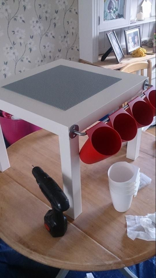 Ikea table (lack) and the rack and pots (bygel) and tesco are selling the Lego mats. Less than £10.