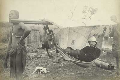 Traveling in a hammock, Belgian Congo [Photograph taken or provided by Émile Gorlia (1887-1966)].