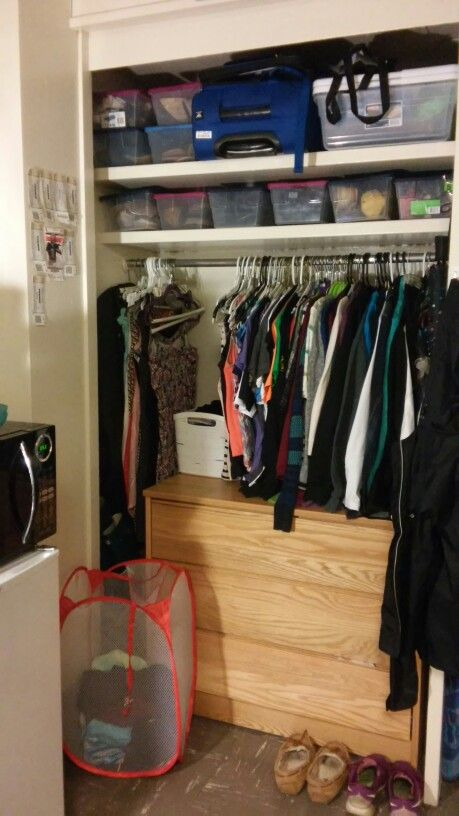 Purdue University dorm closet. Small plastic totes from target are a great way to organize shoes.