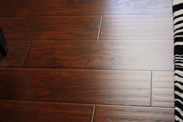 "It's not hardwood.   Wide plank laminate flooring at Sam's Club for $1.50/square foot.  The ""hand scraping"" gives it a ton of character.  The commercial grade quality makes it almost indestructible.  No maintenance, quick and easy installation, and the biggest plus is that NO ONE CAN TELL.  Seriously, no one can tell that it is not the real thing."