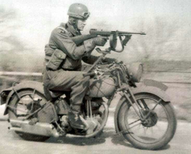British Army test of a Tommy gun mounted on a Norton motorcycle.