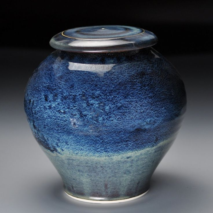 Blue Cosmos ceramic porcelain cremation pet urn. Individually made by an American ceramic artist. Keepsake size 14 cubic inch capacity.
