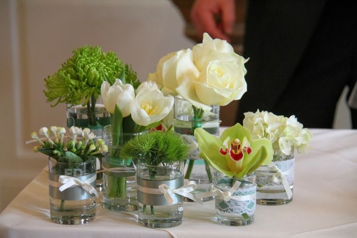 The Registrars table was dressed with clusters of vases filled with fresh green blooms