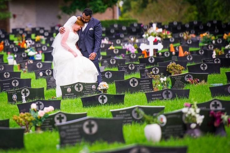 Touching moment as this bride leaves flowers on both her father's and brother's grave prior to her wedding ceremony.