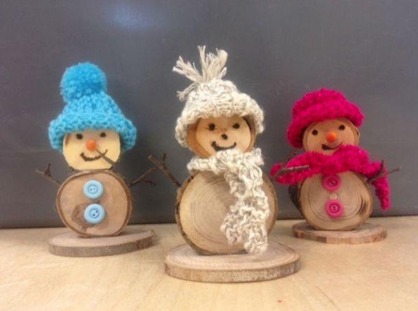 sneeuwpopjes van houtplakjes