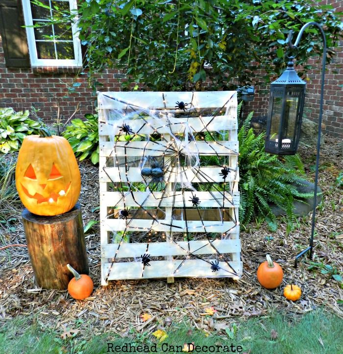 Repurpose a pallet into a big spider web display for Halloween!  A pumpkin would work, too!