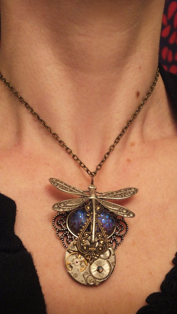 This Steampunk pendant was made using snake eyes glass. It can be worn as a choker or tighter necklace. As a choker, this necklace is made to fit