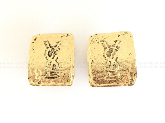 Vintage Yves Saint Laurent YSL Logo Rectangle Clipped Earrings   pping & Policies -100% AUTHENTIC vintage Yves Saint Laurent rectangular shape earrings. -Embossed YSL logo, big hammered earrings. -There are some imperfections such as scuffs/scratches and dirt/stain. -Ranking is B approximately. -Clips are working tight, without problem. -The earrings do not come with original tag/box. -Secured shipping via Japan Post's EMS with tracking number and insurance. Delivery time to most des