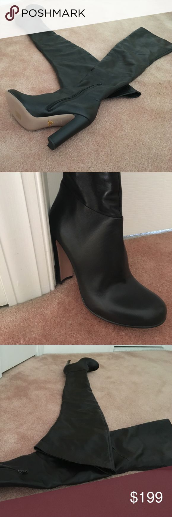Prada over the knee boot. Side Zipper 4 inch heel Never Worn Prada over the knee boot in a soft black Leather. Lots of stretch to pull above the knee. Very Sexy and in Style. Perfect with mini skirts, Jeans or off the shoulder mini dresses. Prada Shoes Over the Knee Boots