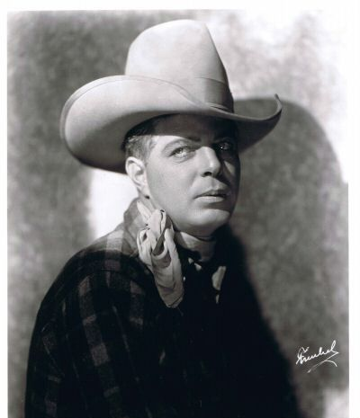 HOOT GIBSON -  (August 6, 1892 – August 23, 1962) was an American rodeo champion and a pioneer cowboy film actor, director and producer.