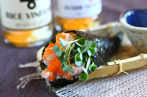 Hand Roll (Temaki Recipe): The creamy seafood filling pairs well with the vinegared sushi rice and the fresh radish sprouts. For the popping sensation in the mouth, I topped some extra masago on top of the filling. This hand roll is delightful. #sushi #japanese #rice