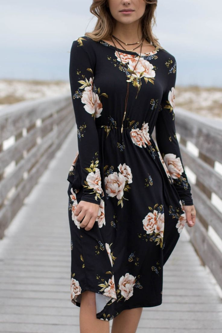- A black dress featuring a floral pattern, pleated details, a round neckline, pockets, elastic waist, no lining, and long sleeves - Material is Polyester and Spandex - Made in the USA Bust Length Sma