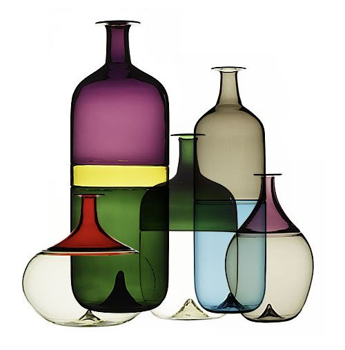 "Tapio Wirkkala is best known for designing the original Finlandia Vodka bottle, inspired by the elements in his native Finland. This series of five bottles in Murano glass, employs the ""Incalmo"" technique where two different types of glass, worked separately, are fused together. Bolle Bottles, 1968, by Tapio Wirkkala, for Venini"