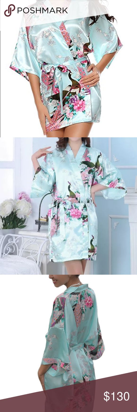 "7 Bridesmaids robes : Light blue and white NWT Bundle of 6 light blue bridesmaid kimono silk robes. Plus one white robe for the bride. 7 robes total. Cute peacock print. Approx. 35"" in length. Has a matching sash to tie around waist. One size fits most. Would like to sell all together. Please inquire if you need a specific amount. All new with tag in plastic package. Also available in light pink and light purple. Intimates & Sleepwear Robes"