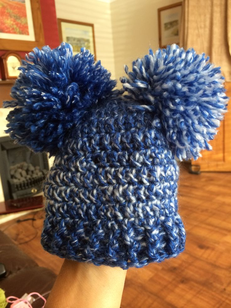 Blue crochet baby beanie with front post trim and DC body