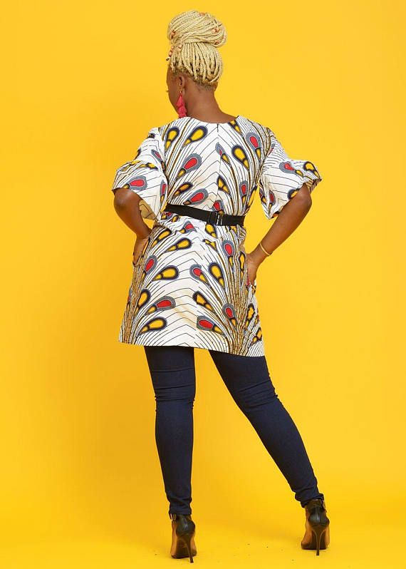 Style #1015WPF The perfect modern African dress to add to your wardrobe. Our Eya dress features a loose fit and fun ruffle sleeves. The African print dress is a lovely white peacock feather print. The African print dress is sure to become your new favorite. Dress it up for a night on the