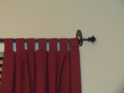 a renter's dream... no screws so the landlord is happy! Large 3M decorative hooks and a narrow curtain rod