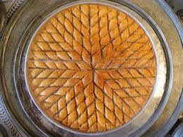 Bosnian Cake - BAKLAVA Ingredients: 8 oz. roll of phyllo dough 3 1/2 c. walnuts, chopped very fine, 2 (8 oz.) bags  1/2 c. butter, melted in saucepan 4 c. sugar 2 3/4 c. water