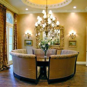 Dining Room   Elegant Chandelier With A Round Dining Table U0026 5 Curved  Seating Banquettes.